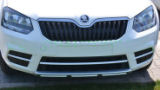 Yeti facelift CITY 14+ OEM Skoda front bumper center lid cover - glossy WHITE Click to view details.